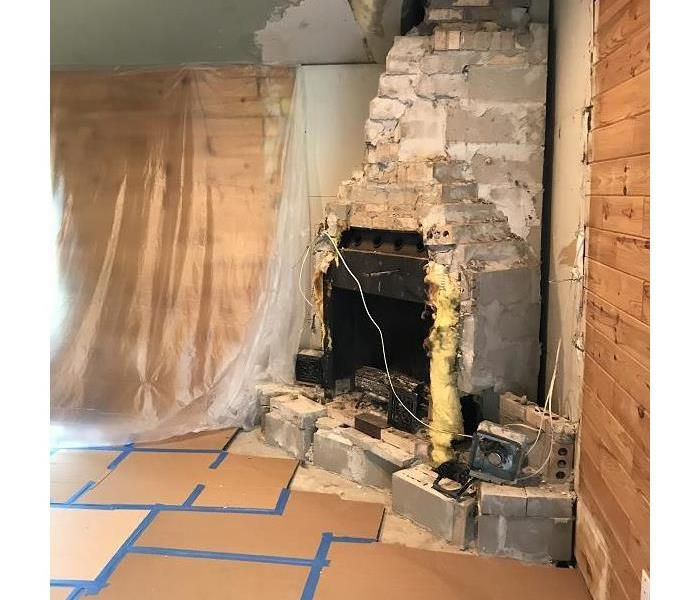 Repairing fireplace after the storm. Before