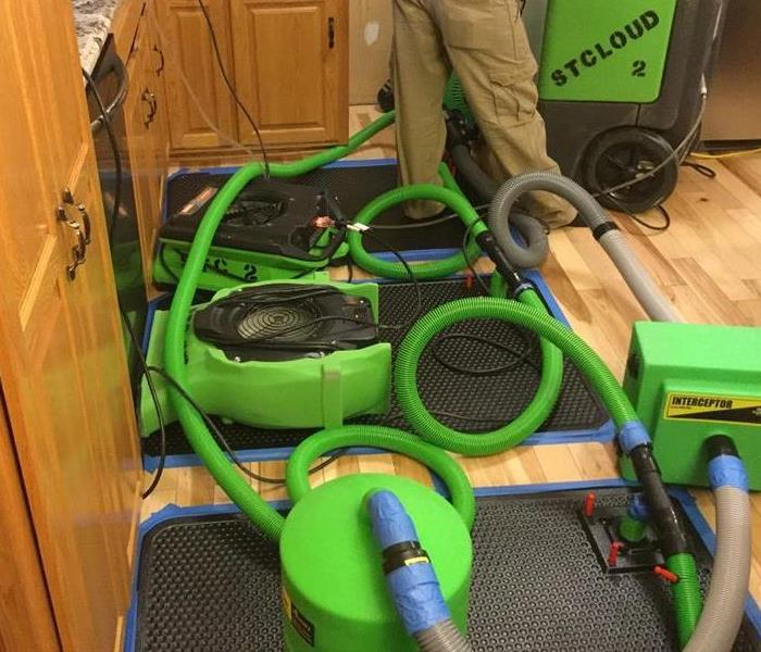 SERVPRO of St. Cloud drying out a floor and saving materials!