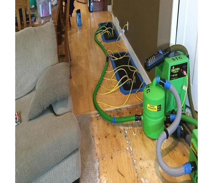 SERVPRO of St. Cloud restoring this hard wood floor