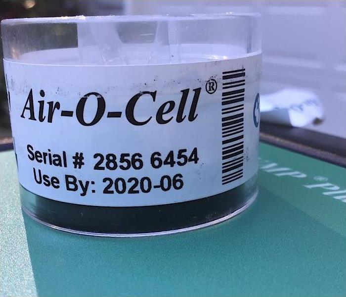 A clear tube that holds a mold test.