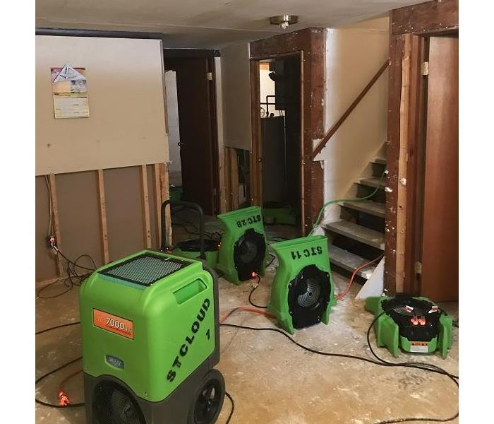 SERVPRO of St. Cloud drying out basement from water loss and working on rebuild