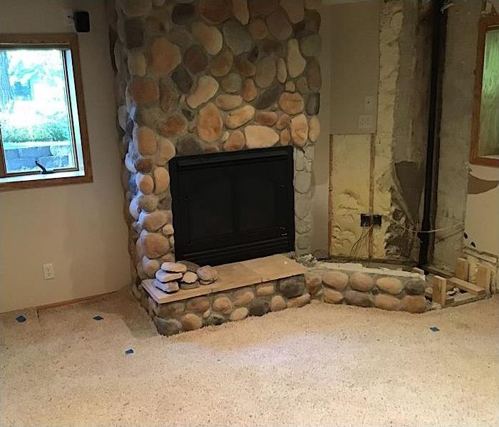 Rock fire place and tv stand tore out due to water damage.