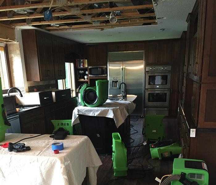 Water damage throughout a kitchen.