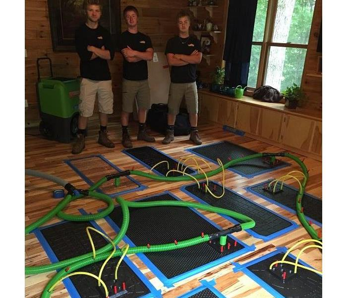 Drying hardwood flooring with the injector dry mat system!