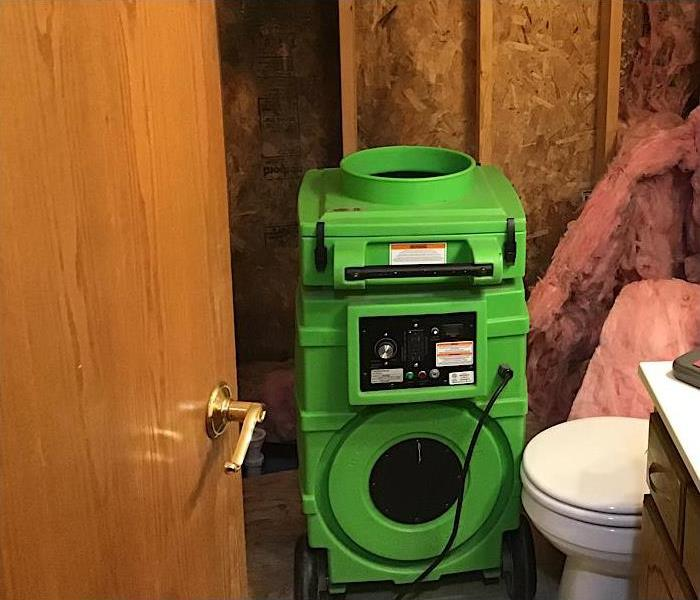 SERVPRO equipment in damaged bathroom.
