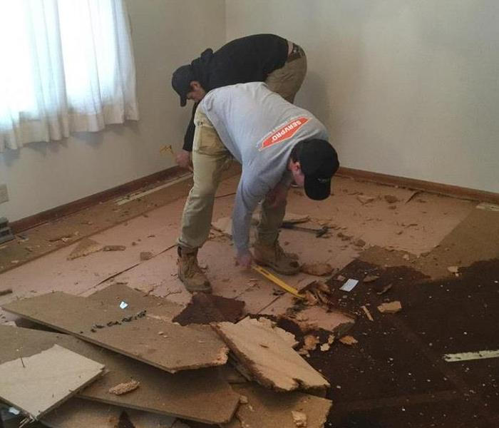 Water damage throughout the flooring.  SERVPRO of St. Cloud tearing out a floor!