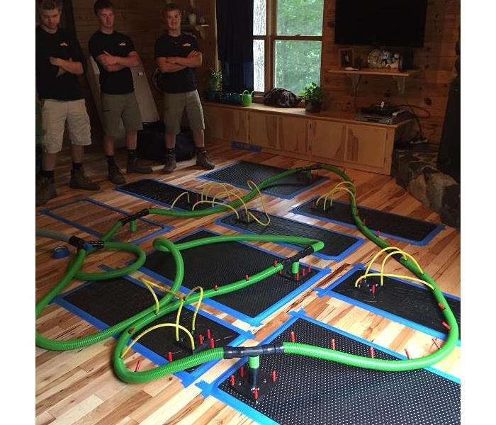 SERVPRO of St. Cloud restoring hard wood flooring with floor drying mat system