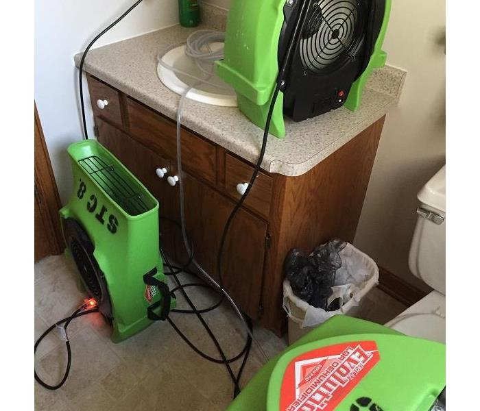 SERVPRO of St. Cloud drying out a bathroom.